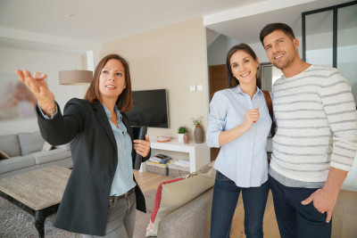 67349015 - couple with real-estate agent visiting house for sale
